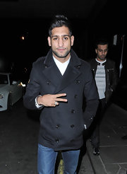 Amir Khan heads to a popular London night spot in a smart double-breasted pea coat.