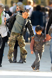 Maddox Jolie-Pitt goofed around in Venice wearing a pair of camouflage cargo pants and a puffer jacket.
