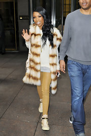 Brandy got a jump start on fall's biggest runway trend in a pair of camel leather leggings.
