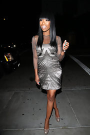 Brandy paired her gray cocktail dress with pearl-finished platform pumps.