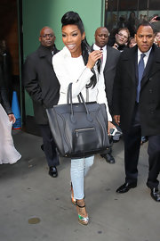 Brandy headed out into NYC after an appearance on 'Good Morning America' wearing a pair of multi-colored platform sandals.