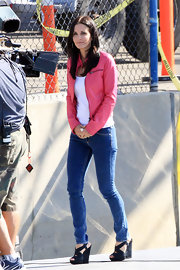 "Courtney Cox films her hit show ""Cougar Town"" in fetching black suede wedges."