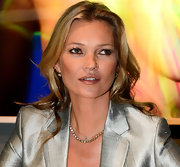 Kate Moss left her hair down in soft waves when she attended the auction of her artworks.