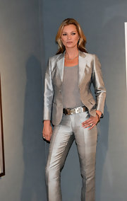 Kate Moss looked fiercely stylish in a silver pantsuit during the auction of her artworks.