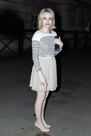 Duffy teamed her nautical striped sweater and ladylike skirt with a pair of ivory patent pumps.