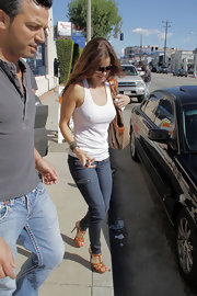 """Gorgeous Ms. B sports an effortlessly hot look complete with the uber popular """"Tribute Too"""" sandals in tan. These platform, leather heels are a stylish and sexy warm weather look that goes great with skinny jeans, shorts or a cute summer dress."""