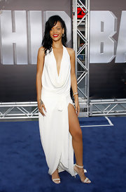 Rihanna paired her sexy Grecian gown with matching white heels and a bright white manicure.