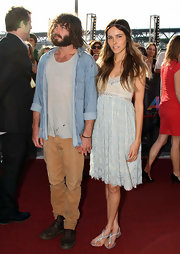 Isabel Lucas channeled her inner flower child in bohemian jeweled sandals with an empire cocktail dress and hippie headband.