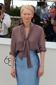 Tilda Swinton looked refined at the 'Moonrise Kingdom' photocall wearing this mauve tie-neck blouse and a pencil skirt.