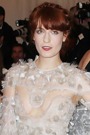 Florence Welch styled her hair in a bold Heidi braid with long lash-grazing bangs for the Met Gala.