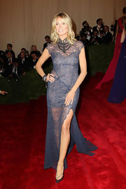 Heidi Klum stepped out to the Met Gala wearing a pair of shiny textured pumps.