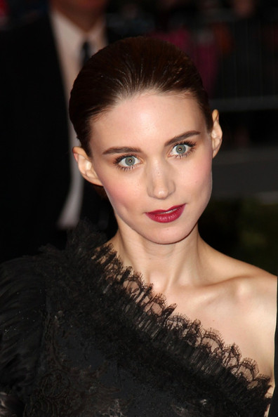 Rooney Mara gave her black outfit a pop of color with a sweep of red lipstick.