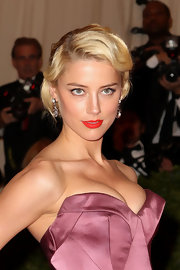 Amber Heard hit the red carpet at the Met Gala wearing her hair in a sleek retro-inspired style.