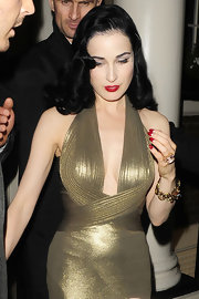 Dita Von Teese brushed on vivid red lacquer before a night on the town in London.