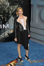 Sienna Guillory paired a leather jacket with an asymmetrical skirt for a unique blend of textures.
