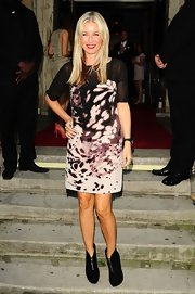 Denise van Outen matched her dress with pair of front-zip suede boots.