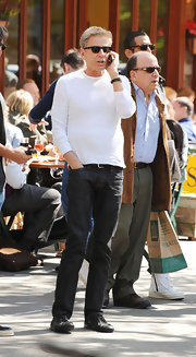 Calvin Klein paired his basic white top with a dark pair of jeans.
