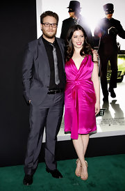 Lauren Miller kept the focus on her fuchsia cocktail dress with strappy nude heels.