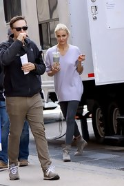Cameron Diaz chose an oversized V-neck sweater in a light lavender for her on set look while in NYC.