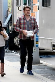 Nikolaj Coster-Waldau kept it casual on set with a plaid button down.