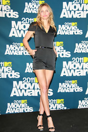Cameron Diaz donned a black silk romper for the MTV Movie Awards to show off her long toned legs.