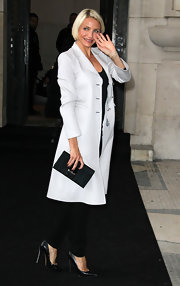 Cameron Diaz exuded elegance in an ultra-chic white coat.