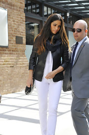 Camila Alves added some edge to her all-white look with this black leather jacket.