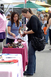Camryn Manheim showed off a large black hobo bag which was embellished with ruffled fabric.