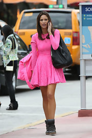 Nikki Novak was pretty in pink in a hot pink cocktail dress and matching travel bag.
