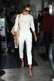 Candice Swanepoel paired a classic white tee with white capris for a clean and fresh look.
