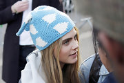 Cara Delevingne fought the winter chill with style in this baby blue and white knit beanie.
