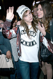 Cara Delevingne was definitely rolling with her homies in Paris when she sported this white 'Homies' beanie.