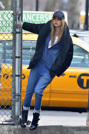Cara Delevingne chose a puffy down coat for her look on set of a DKNY photo shoot.