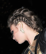 Cara Delevigne wore a pair of dangerous ear cuffs at the DKNY event.