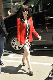 What's black and white and red all over? Carly Rae Jepsen of course! Carly rocked this vibrant blazer while out in NYC.