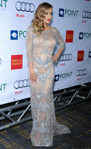 Carmen Electra looked jaw-droppingly gorgeous in a beaded, sheer evening dress at the Voices on Point musical gala.
