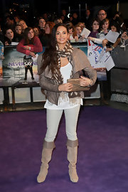 Alesha Dixon's tan crocodile clutch was an elegant finish to her edgy ensemble at the 'Never Say Never' premiere.