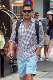 Cash Warren was casual in a gingham button-down and blue shorts as he went for a stroll in NYC.