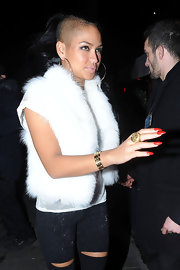 Cassie wore her stiletto nails polished with bright orange-red lacquer while out at a club in London.