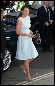 Kate wore a powder blue dress that just barely showed off her baby bump to a charity event at London's National Portrait Gallery.