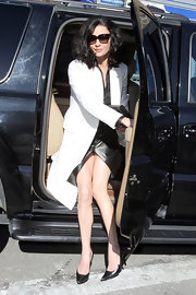 Caterhine Zeta Jones stepped out of a car in pointy black leather stilettos.