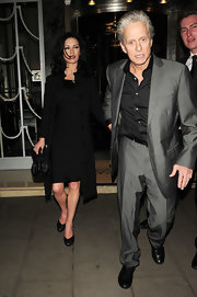 Catherine donned a sleek LBD under a black evening coat while out with husband, Michael Douglas in London.
