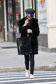 Catherine Zeta Jones kept a low profile in NYC, paired her fur coat with sneakers and a black leather tote.