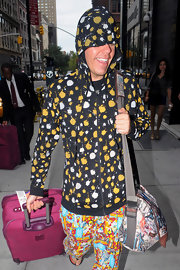 Perez Hilton arrived at his NYC hotel looking vibrant in a hoodie and pants with clashing prints.