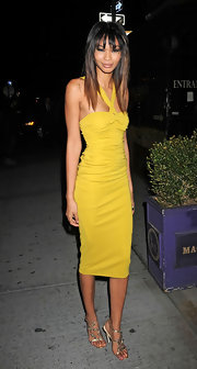 Chanel topped off her yellow cocktail dress with embellished strappy sandals.