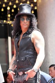 Slash attended his Walk of Fame ceremony wearing an edgy black leather vest and his trademark top hat.