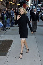 Charlize Theron accessorized her TV-ready ensemble with black strappy sandals.
