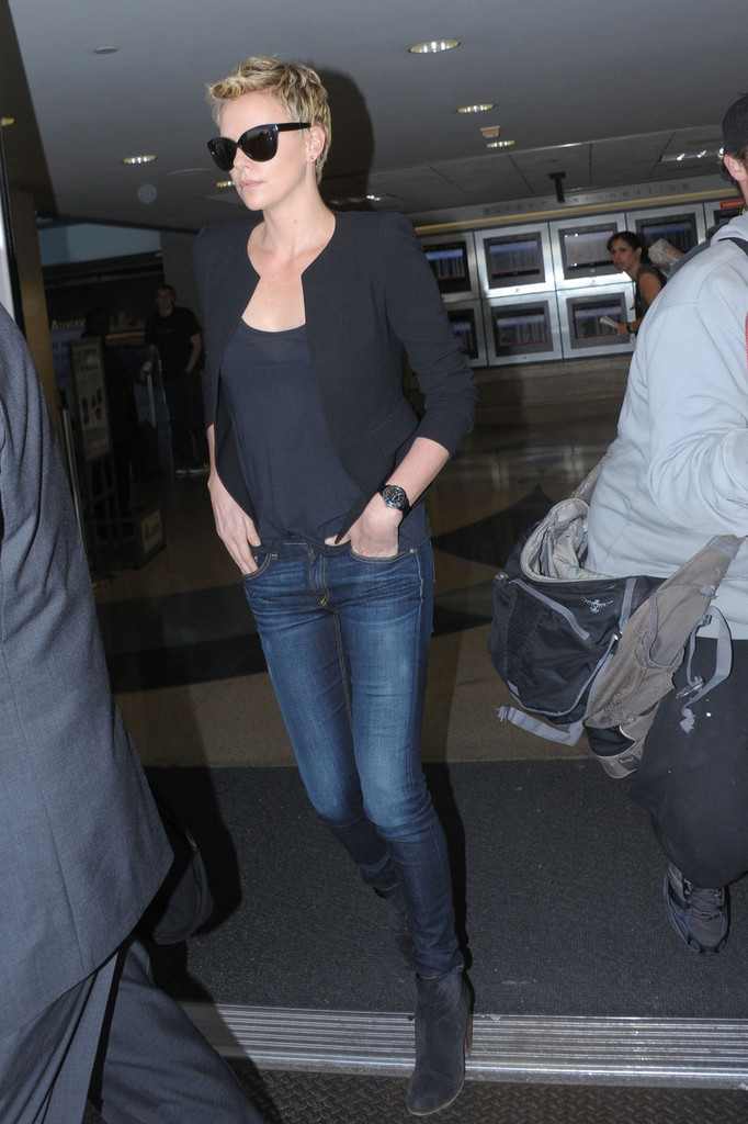 Charlize Theron makes her way through LAX  Airport.
