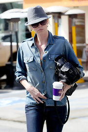 Charlize tried out the denim on denim trend in Hollywood in a faded blue button-down top.