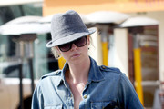 Charlize Theron is spotted carrying coffee as she leaves a spa in Hollywood.